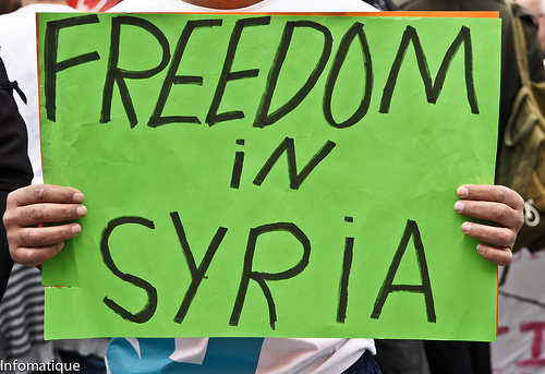 protest sign freedom in syria